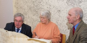 From the left, Keith Sweetmore explains to Gill Woodhead and John Lund the meaning of the parchments.