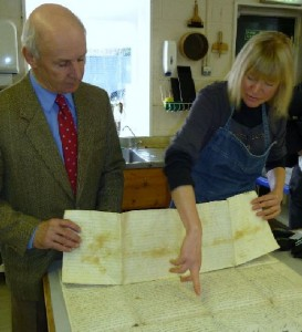 John Lund (left) has further damage pointed out by Rachel Greenwood, Conservator.