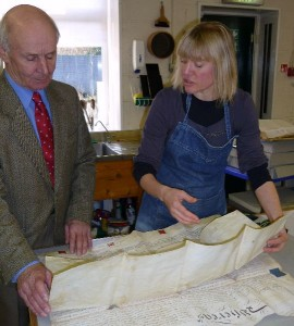 John Lund, left, checks damage with Rachel Greenwood, Conservator.